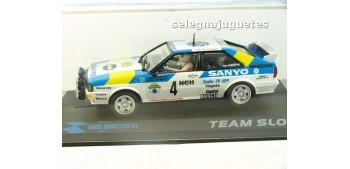 Audi Quattro A1 Stig Blomqvist - Bjorn Cederberg - SANYO - escala 1/32 slot vitrina rota