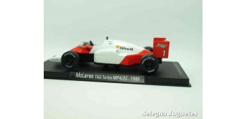 coche miniatura McLaren Tag turbo MP4/2C 1986 (vitrina defecto)
