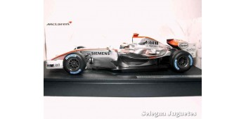 miniature car MCLAREN MP4/21 2006 - K. RAIKKONEN - 1/18 HOT